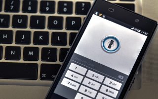 Cell phone with password protected lock screen and laptop